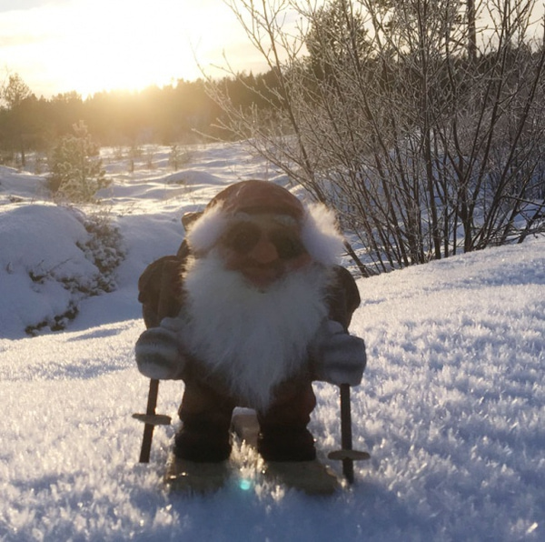 Image of Ny Form santa skiing with backpack