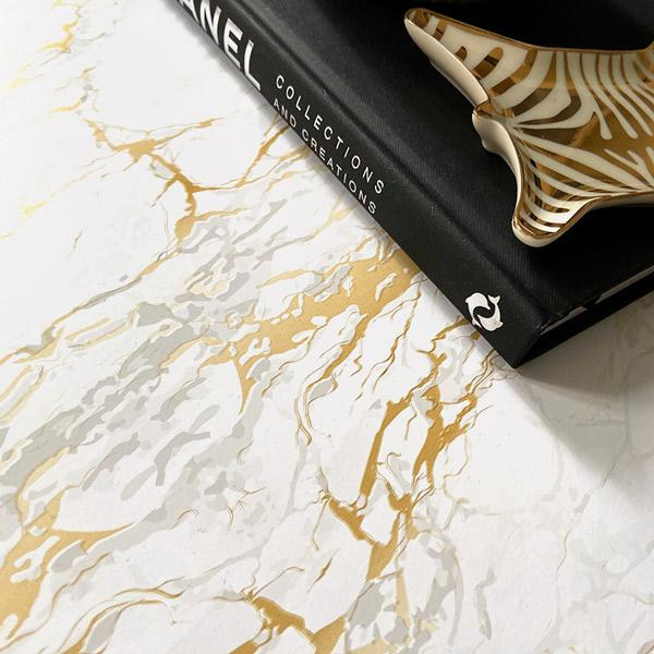 Bilde av Marmor hvit/gull kontaktplast